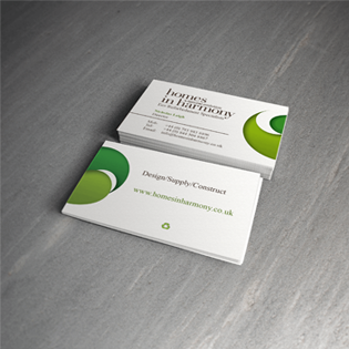 Homes in Harmony business cards stacked showing front and back